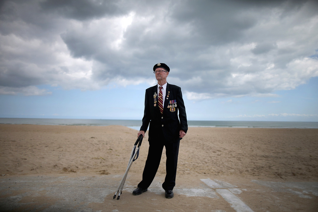 Description of . D-Day veteran Cecil Deller, aged 89, from Cambridgeshire, stands on Sword Beach on June 5, 2014 in Hermanville, France.  (Photo by Christopher Furlong/Getty Images)