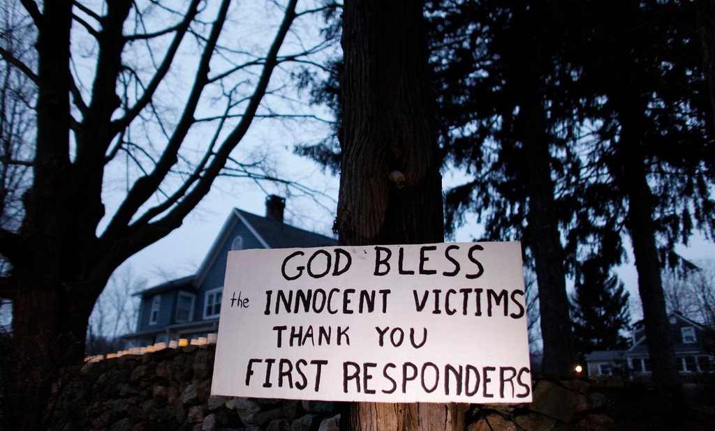 Description of . A message of thanks and prayer is displayed outside a home in the wake of a deadly school shooting, Sunday, Dec. 16, 2012, in Newtown, Conn.  A gunman walked into Sandy Hook Elementary School in Newtown on Friday and opened fire, killing 26 people, including 20 children. (AP Photo/Jason DeCrow)