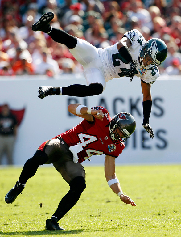 Description of . Philadelphia Eagles defensive back Nnamdi Asomugha (24) goes airborne after knocking the ball away from Tampa Bay Buccaneer's Dallas Clark (44) during the second half of their NFL football game, Sunday, Dec. 9, 2012, in Tampa, Fla. The Eagles won 23-21. (AP Photo/The Philadelphia Inquirer, Ron Cortes)