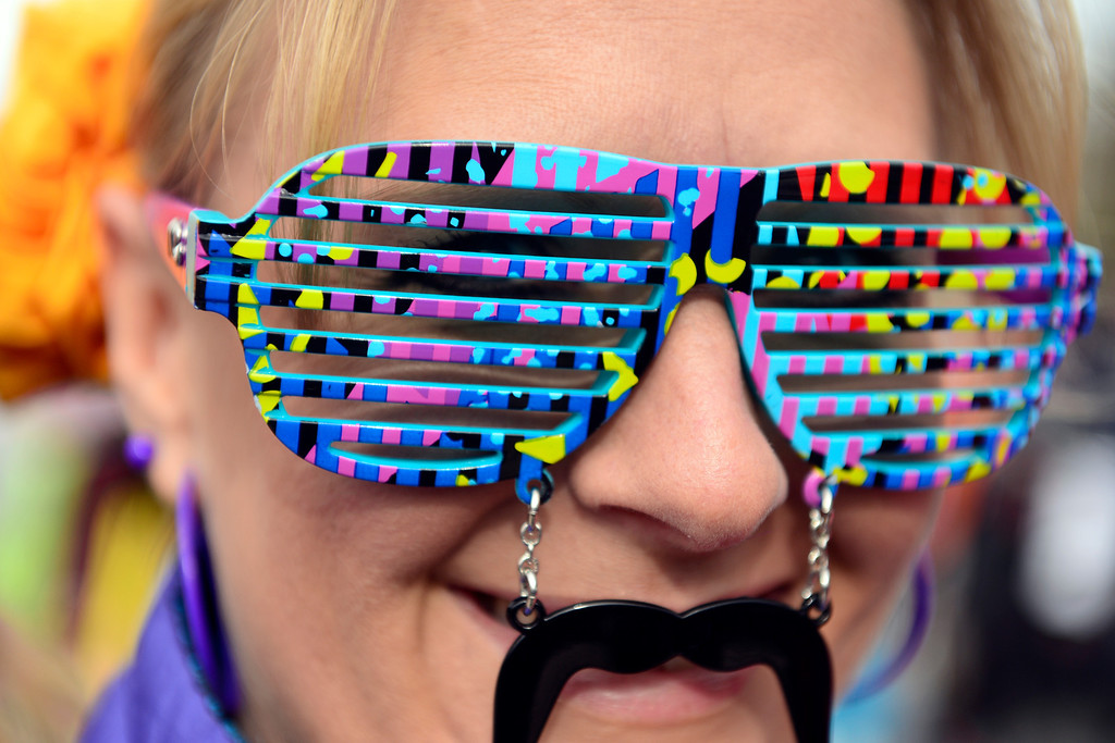 Description of . ASPEN, CO - JANUARY 26: Nicole Lopez, of Grand Junction, rocks a mustache with novelty sunglasses during the men's snowboard slopestyle final. X Games Aspen Buettermilk Mountain Aspen January 26, 2013 (Photo By AAron Ontiveroz / The Denver Post)