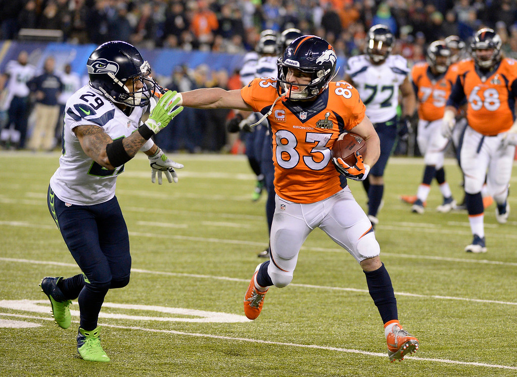 Description of . Denver Broncos wide receiver Wes Welker (83) runs with the ball chased by Seattle Seahawks free safety Earl Thomas (29) during the third quarter. The Denver Broncos vs the Seattle Seahawks in Super Bowl XLVIII at MetLife Stadium in East Rutherford, New Jersey Sunday, February 2, 2014. (Photo by John Leyba/The Denver Post)