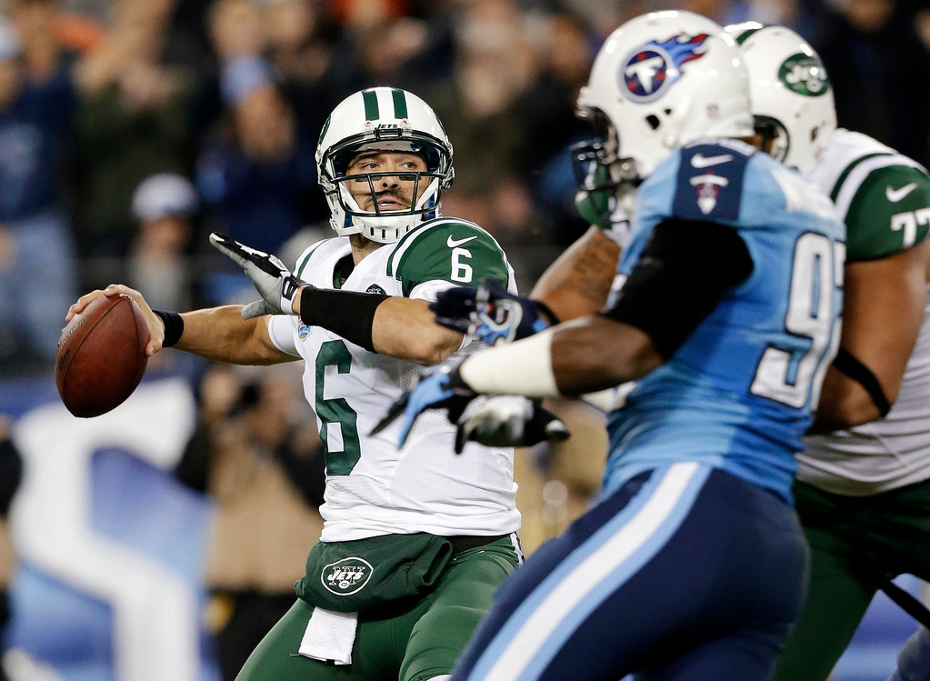 Description of . New York Jets quarterback Mark Sanchez (6) passes against the Tennessee Titans in the second quarter of an NFL football game, Monday, Dec. 17, 2012, in Nashville, Tenn. (AP Photo/Wade Payne)
