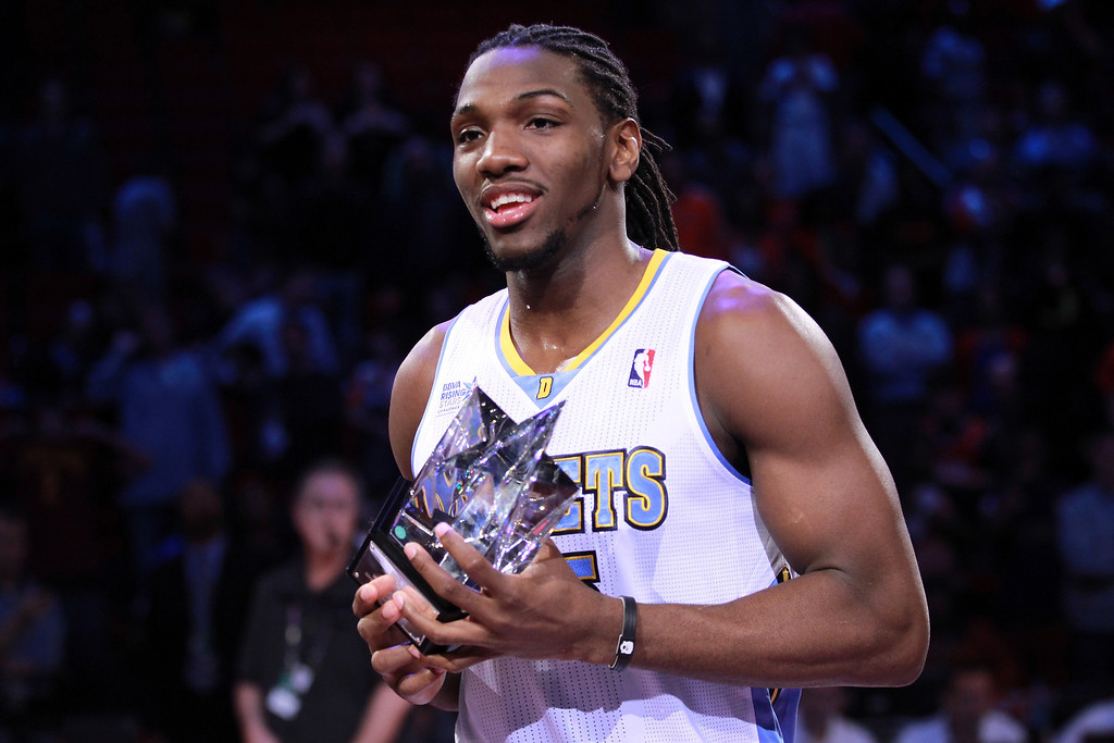 Description of . HOUSTON, TX - FEBRUARY 15:  Kenneth Faried #35 of the Denver Nuggets and Team Chuck holds up the MVP trophy after the BBVA Rising Stars Challenge 2013 part of the 2013 NBA All-Star Weekend at the Toyota Center on February 15, 2013 in Houston, Texas.   (Photo by Ronald Martinez/Getty Images)