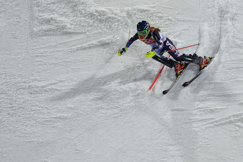 Description of . US skier Mikaela Shiffrin skis to gold in the Women's Alpine Skiing Slalom Run 2 at the Rosa Khutor Alpine Center during the Sochi Winter Olympics on February 21, 2014.      AFP PHOTO / DIMITAR DILKOFF/AFP/Getty Images