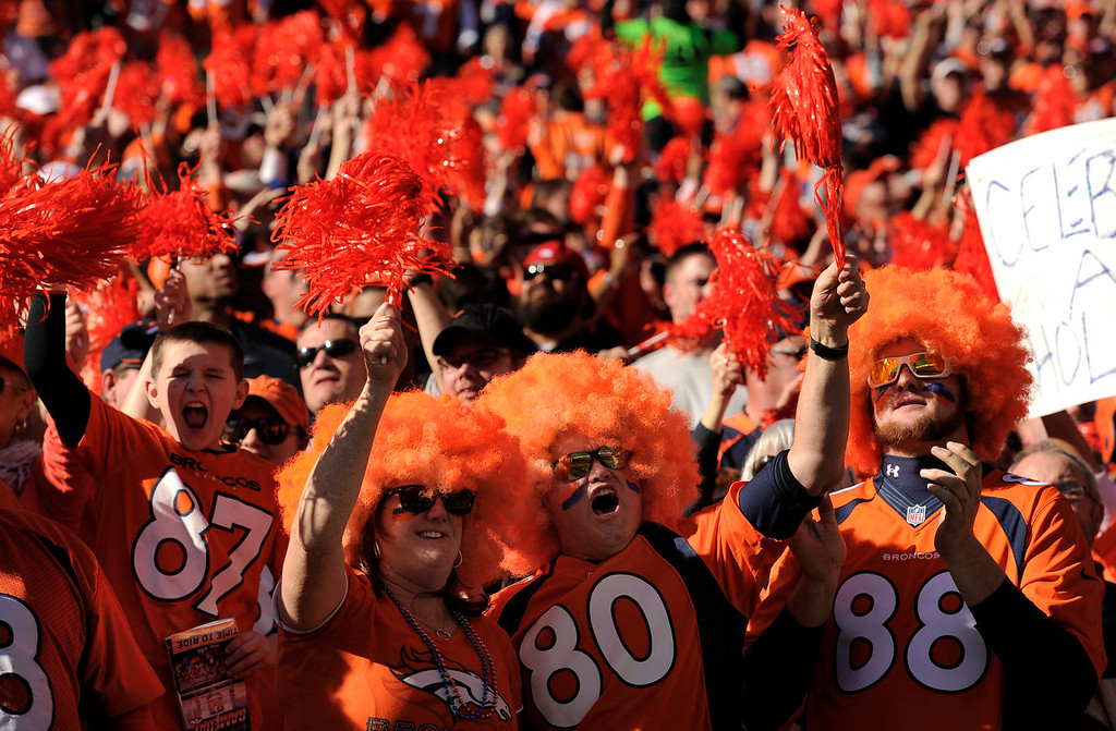 Description of . Broncos fans cheer on the team prior to the start of the game.  The Denver Broncos vs. The New England Patriots in an AFC Championship game  at Sports Authority Field at Mile High in Denver on January 19, 2014. (Photo by Helen Richardson/The Denver Post)