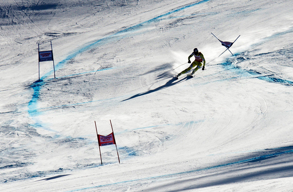 Description of . Aksel Lund Svindal of Norway carves past a gate to take second in the FIS Alpine World Cup men\'s Super G on December 1, 2012 in Beaver Creek, Colorado.     DON EMMERT/AFP/Getty Images