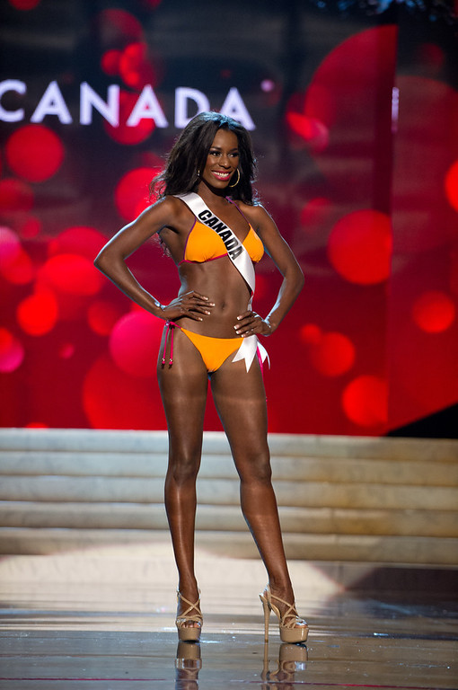 Description of . Miss Canada 2012, Adwoa Yamoah, competes during the Swimsuit Competition of the 2012 Miss Universe Presentation Show on Thursday, Dec. 13, 2012 at PH Live in Las Vegas. The 89 Miss Universe Contestants will compete for the Diamond Nexus Crown on December 19.  (AP Photo/Miss Universe Organization L.P., LLLP)