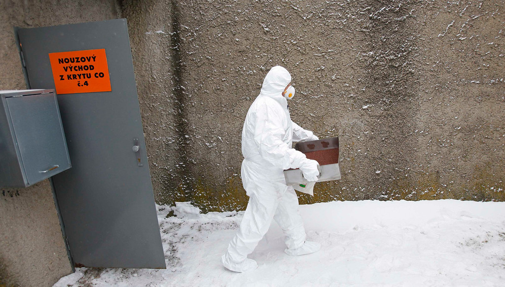 Description of . A worker wearing a protective suit and a mask exits a fallout shelter during a nuclear accident simulation as part of a safety regulations exercise at Nuclear Power Plant Dukovany in Dukovany March 26, 2013.     REUTERS/David W Cerny