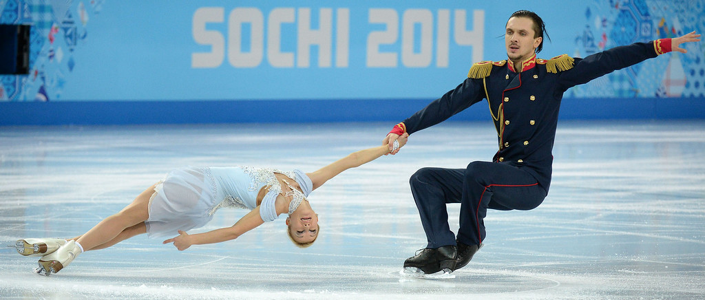 Description of . Russia\'s Tatiana Volosozhar and Russia\'s Maxim Trankov perform in the Figure Skating Pairs Short Program at the Iceberg Skating Palace during the 2014 Sochi Winter Olympics on February 11, 2014.    YURI KADOBNOV/AFP/Getty Images