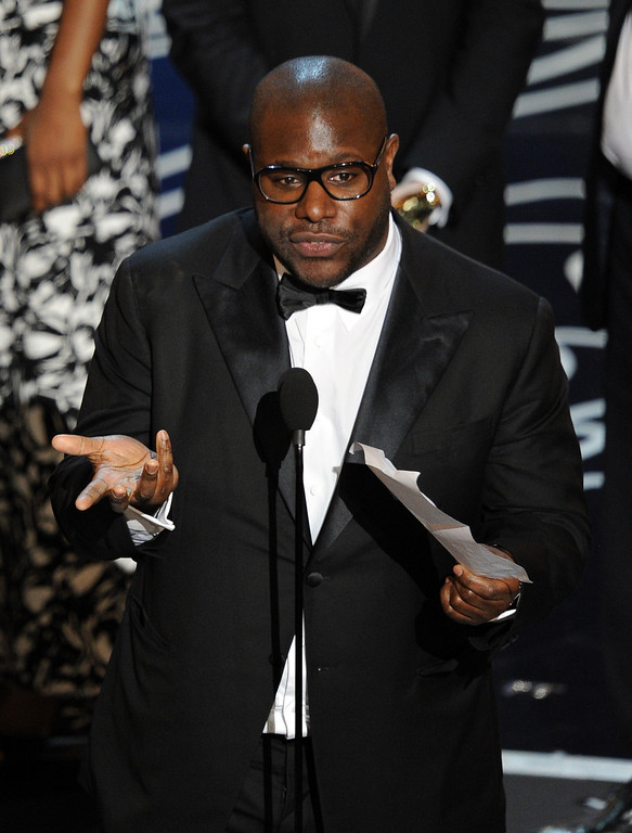 Description of . Director Steve McQueen accepts the Best Picture award for '12 Years a Slave' onstage during the Oscars at the Dolby Theatre on March 2, 2014 in Hollywood, California.  (Photo by Kevin Winter/Getty Images)