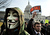 A demonstrator wears a Guy Fawkes mask during an 