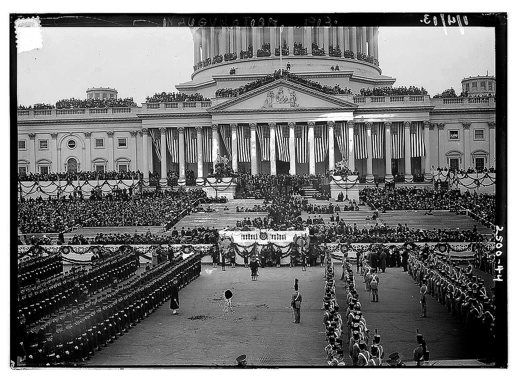 Description of . Photo shows the crowd and lines of cadets at the United States Capitol, Washington, D.C., for the first inauguration of President Woodrow Wilson, March 4, 1913. (Photo from The Library of Congress)