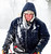 Bartholomew County Jail employee Rick Thompson battles the wind, and the snow blown into the air by his own equipment while clearing the walks at the facility in Columbus, Ind. Wednesday, Dec. 26, 2012. The blizzard warning issued the day before by National Weather Service came to fruition in the region Wednesday as winds picked up and snow began falling in earnest before dawn. (AP Photo/The Republic, Joe Harpring)