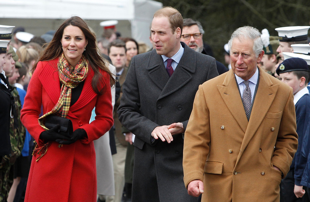 Description of . Catherine, Duchess of Cambridge, Prince William, Duke of Cambridge and Prince Charles visit Dumfries House on March 05, 2013 in Ayrshire, Scotland. The Duke and Duchess of Cambridge braved the bitter cold to attend the opening of an outdoor centre in Scotland today. The couple joined the Prince of Wales at Dumfries House in Ayrshire where Charles has led a regeneration project since 2007. Hundreds of locals and 600 members of youth groups including the Girl Guides and Scouts turned out for the official opening of the Tamar Manoukin Outdoor Centre. (Photo by Danny Lawson - WPA Pool/Getty Images)