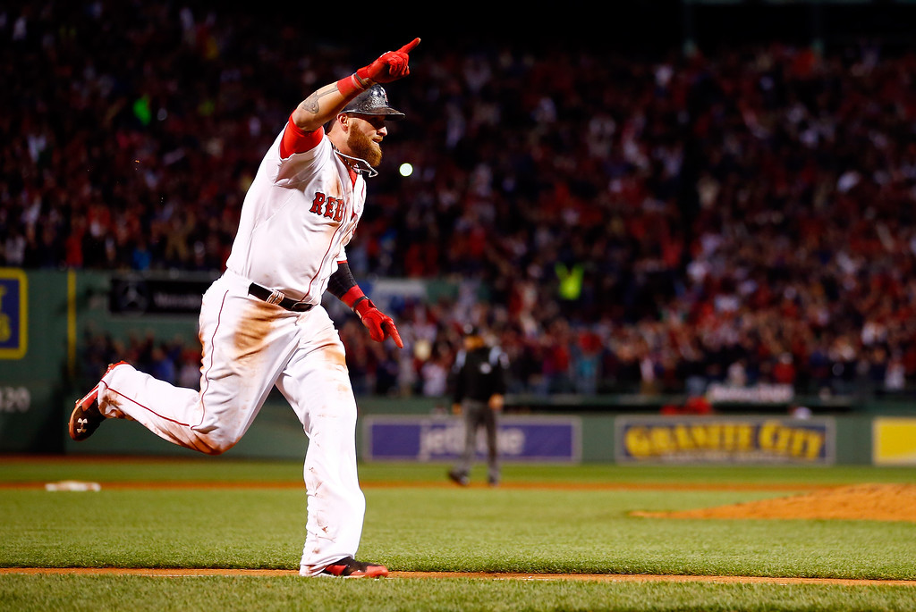 Description of . Jonny Gomes #5 of the Boston Red Sox scores the winning run against the Detroit Tigers in Game Two of the American League Championship Series at Fenway Park on October 13, 2013 in Boston, Massachusetts.  (Photo by Jared Wickerham/Getty Images)