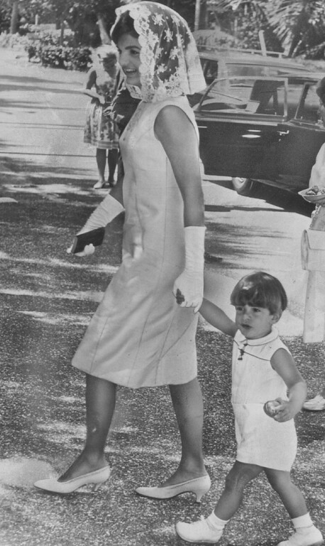 Description of . Jacqueline walks with John Jr. on April 15, 1963.