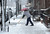 A man clears snow as a snow storm hits New York, March 8, 2013. AFP PHOTO/EMMANUEL  DUNAND/AFP/Getty Images