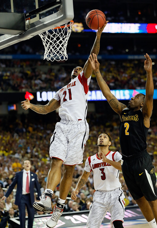 Description of . ATLANTA, GA - APRIL 06:  Chane Behanan #21 of the Louisville Cardinals goes up for a shot against Malcolm Armstead #2 of the Wichita State Shockers in the second half during the 2013 NCAA Men's Final Four Semifinal at the Georgia Dome on April 6, 2013 in Atlanta, Georgia.  (Photo by Kevin C. Cox/Getty Images)