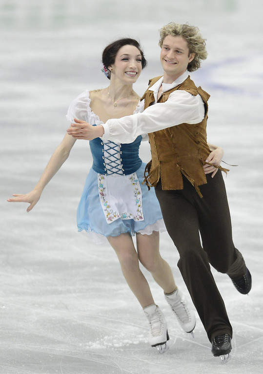 Description of . Meryl Davis and Charlie White of USA skate in the Ice Dance Short Dance during day one of the ISU Four Continents Figure Skating Championships at Osaka Municipal Central Gymnasium on February 8, 2013 in Osaka, Japan.  (Photo by Atsushi Tomura/Getty Images)