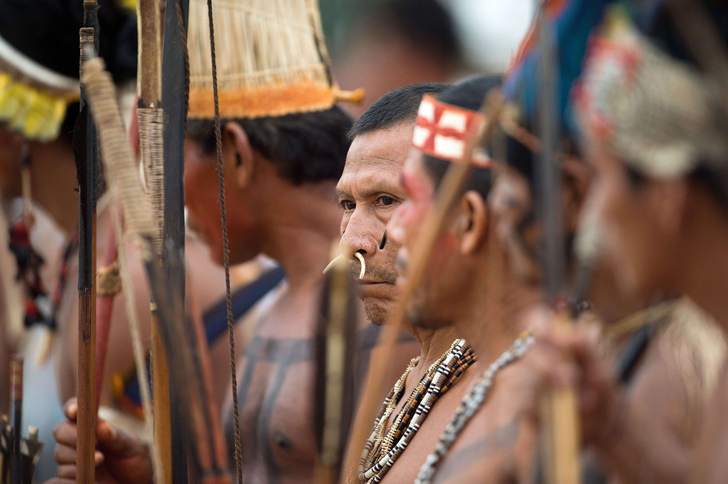 Description of . A Brazilian indigenous man of the Matis tribe waits to take part in the bow and arrow competition during the XII International Games of Indigenous Peoples in Cuiaba, Mato Grosso state, Brazil on November 12, 2013. AFP PHOTO / Christophe SIMON/AFP/Getty Images