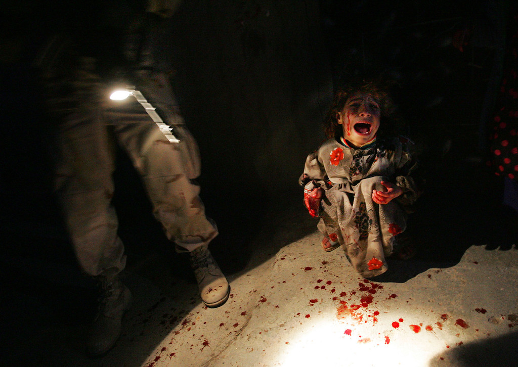 Description of . Samar Hassan, 5, screams after her parents were killed by U.S. Soldiers with the 25th Infantry Division in a shooting January 18, 2005 in Tal Afar, Iraq. The troops fired on the Hassan family car when it unwittingly approached them during a dusk patrol in the tense northern Iraqi town. Parents Hussein and Camila Hassan were killed instantly, and a son Racan, 11, was seriously wounded in the abdomen. Racan, paralyzed from the waist down, was treated later in the U.S. (Photo by Chris Hondros/Getty Images)