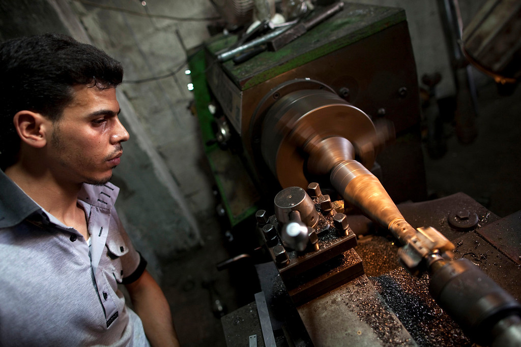 Description of . A man uses a lathe as he makes an improvised mortar shell to be used by rebel fighters at a factory in the city of Aleppo, Syria's commercial capital, on July 7, 2013. Syria's 27-month war between rebel forces and pro-government troops has killed more than 100,000 people, a monitoring group group estimates. JM LOPEZ/AFP/Getty Images