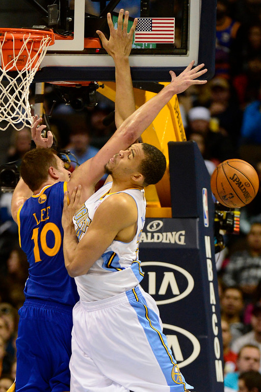 Description of . Denver Nuggets center JaVale McGee (34) Golden State Warriors power forward David Lee (10) during the second half of the Nuggets' 116-105 win at the Pepsi Center on Sunday, January 13, 2013. AAron Ontiveroz, The Denver Post