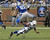 Brandon Pettigrew #87 of the Detroit Lions leaps over the tackle attempt of Joel Lefeged #35 of the Indianapolis Colts at Ford Field on December 2, 2012 in Detroit, Michigan.  (Photo by Dave Reginek/Getty Images)