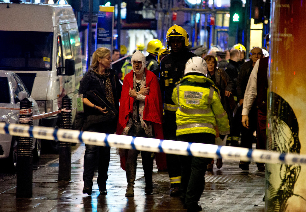 """. A woman stands bandaged and wearing a blanket  given by emergency services  following an incident at the Apollo Theatre, in London\'s Shaftesbury Avenue, Thursday evening, Dec. 19, 2013, during a performance at the height of the Christmas season, with police saying there were \""""a number\"""" of casualties. It wasn\'t immediately clear if the roof, ceiling or balcony had collapsed  during a performance. Police said they \""""are aware of a number of casualties,\"""" but had no further details. (AP Photo by Joel Ryan, Invision)"""