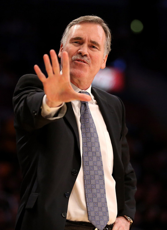 Description of . Head coach Mike D'Antoni of the Los Angeles Lakers complains to a referee in the game with the Denver Nuggets at Staples Center on January 6, 2013 in Los Angeles, California.   (Photo by Stephen Dunn/Getty Images)