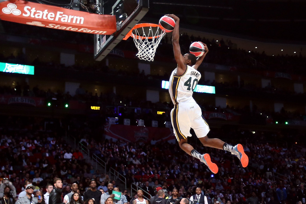 Description of . HOUSTON, TX - FEBRUARY 16:  Jeremy Evans of the Utah Jazz dunks two basketballs in the second round during the Sprite Slam Dunk Contest part of 2013 NBA All-Star Weekend at the Toyota Center on February 16, 2013 in Houston, Texas.  (Photo by Ronald Martinez/Getty Images)