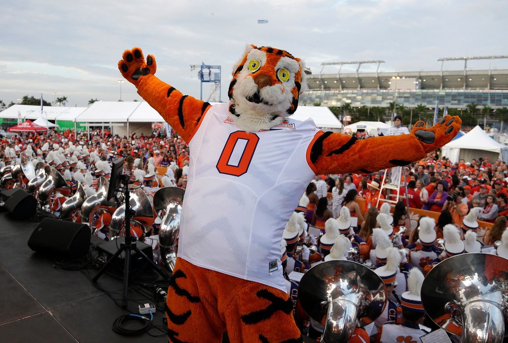 Description of . A Clemson mascot performs on stage for fans before the Orange Bowl NCAA college football game between Clemson and Ohio State, Friday, Jan. 3, 2014, in Miami Gardens, Fla. (AP Photo/Lynne Sladky)
