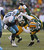 Sam Shields #37 of the Green Bay Packers sacks Jake Locker #10 of the Tennessee Titans at Lambeau Field on December 23, 2012 in Green Bay, Wisconsin. The Packers defeated the Titans 55-7. (Photo by Jonathan Daniel/Getty Images)