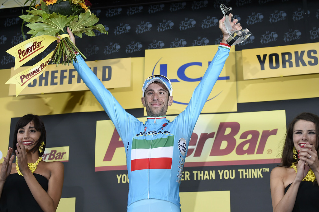 Description of . Stage winner Italy's Vincenzo Nibali celebrates on the podium after winning the 201 km second stage of the 101th edition of the Tour de France cycling race on July 6, 2014 between York and Sheffield, northern England.  AFP PHOTO / ERIC FEFERBERGERIC FEFERBERG/AFP/Getty Images