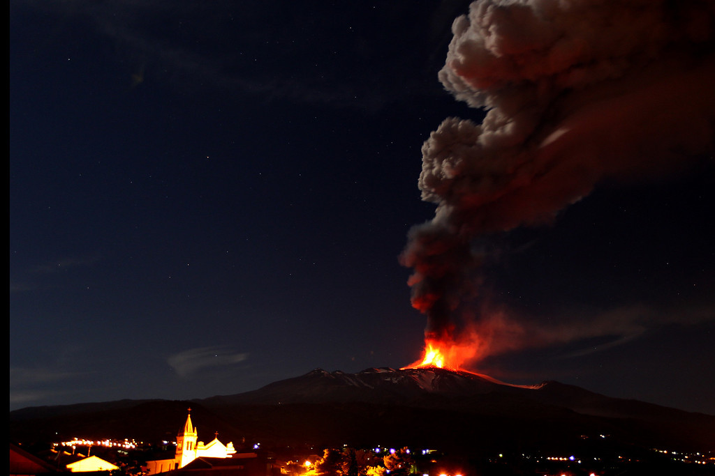 Description of . Mt. Etna, Europe's most active volcano, spews lava as smoke billows during an eruption as seen from Acireale, near the Sicilian town of Catania, Italy, Saturday, Nov. 16, 2013. (AP Photo/Carmelo Imbesi)