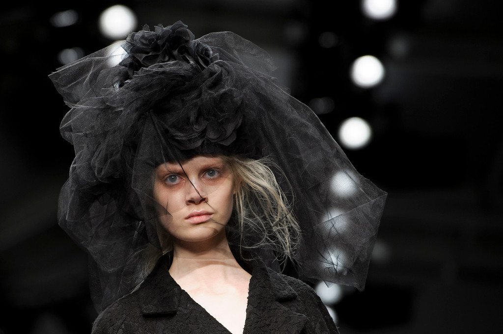 Description of . A model wears a design from the John Rocha collection during London Fashion Week, Saturday, Feb. 16, 2013. (Photo by Jonathan Short/Invision/AP)