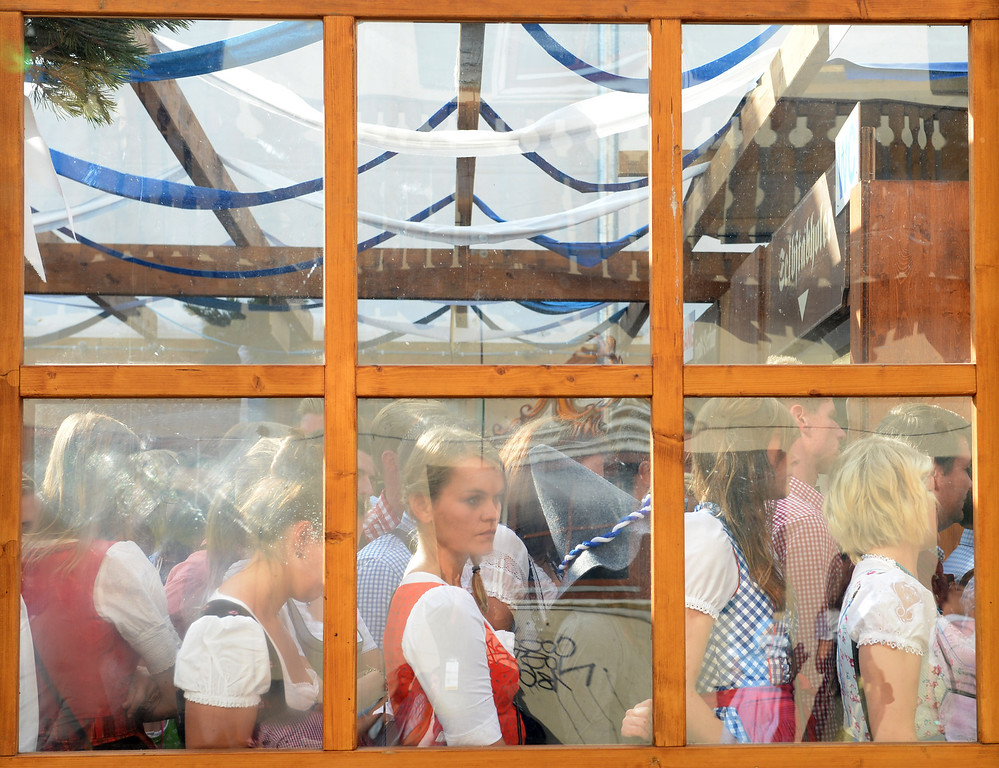 Description of . Visitors stand in a festival tent during the Oktoberfest beer festival at the Theresienwiese in Munich, southern Germany, on September 21, 2013. The world's biggest beer festival Oktoberfest will run until October 6, 2013.  AFP PHOTO / CHRISTOF STACHE/AFP/Getty Images