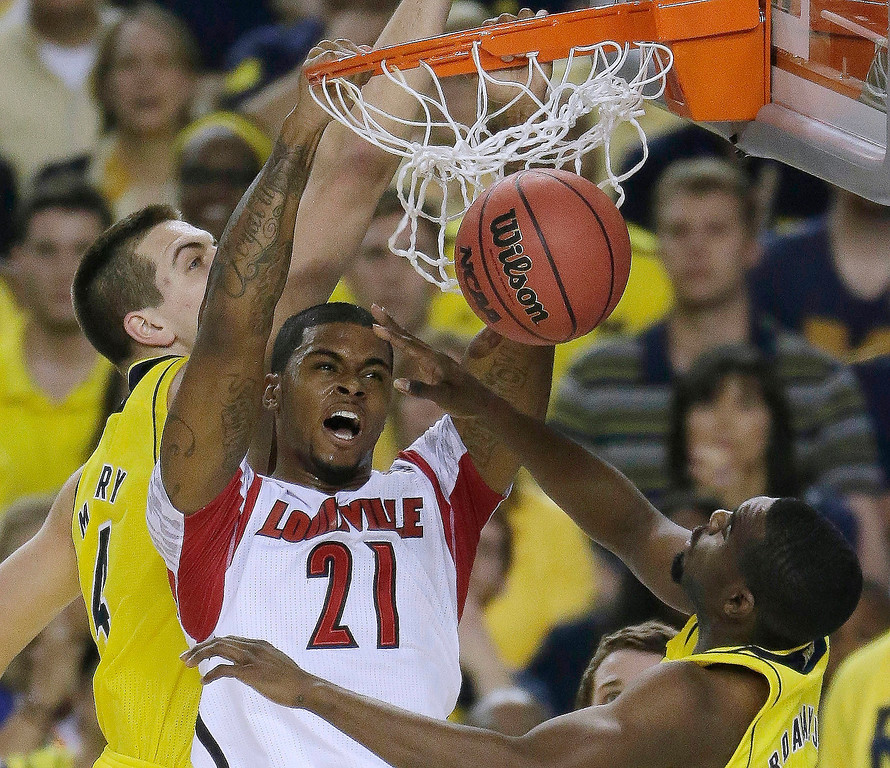 Description of . Louisville forward Chane Behanan (21) dunks against the Michigan during the first half of the NCAA Final Four tournament college basketball championship game Monday, April 8, 2013, in Atlanta. (AP Photo/Chris O'Meara)
