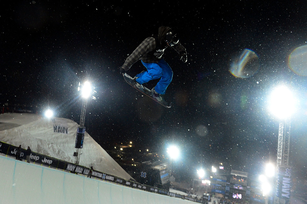 Description of . ASPEN, CO. - JANUARY 24:  Benji Farrow gets some air during the Men's SuperPipe practice at the 2013 Aspen X Games on Buttermilk Mountain on January 24, 2013. (Photo By Mahala Gaylord / The Denver Post)