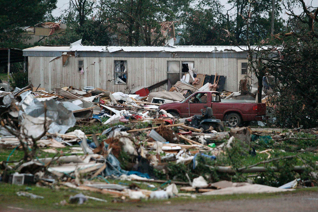 Description of . Debris is seen at a mobile home park which was destroyed by a tornado on Sunday, west of Shawnee, Oklahoma May 19, 2013. A tornado half a mile wide struck near Oklahoma City on Sunday, part of a massive storm front that hammered the central United States. News reports said at least one person had died. REUTERS/Bill Waugh