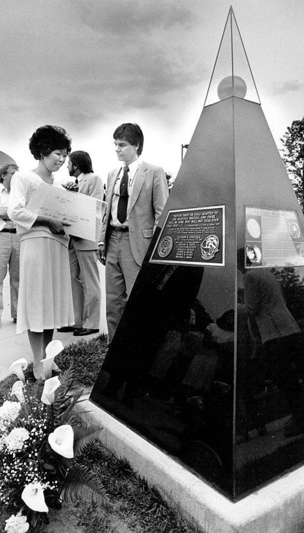 Description of . Lorna Onizuka (left), widow of astronaut Ellison Onizuka, and Colorado University faculty member Dr. Thomas Ayres view a pyramid-shaped memorial representing the sun, following dedication ceremonies Tuesday afternoon, May 1, 1987. The Colorado Scale Model Solar System is dedicated in memory of Ellison Onizuka, a University of Colorado alumnus, and his six crew mates of the space shuttle Challenger. The memorial is located on the C.U. campus.  Mike Lang, Denver Post Library Archive