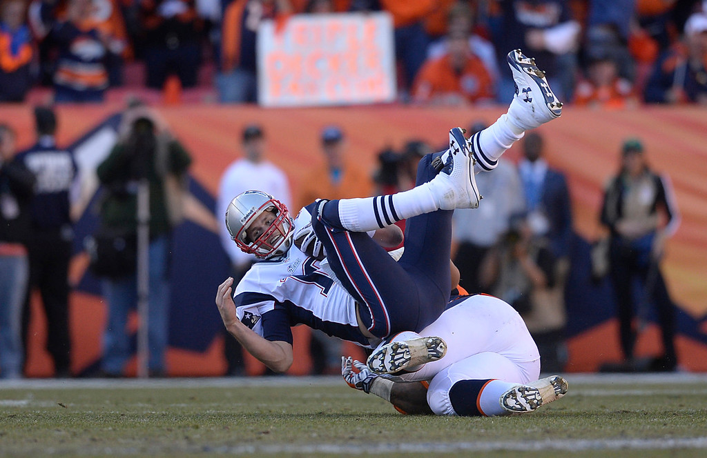 Description of . Denver Broncos defensive tackle Terrance Knighton (94) sacks New England Patriots quarterback Tom Brady (12) on 4th and 2 in the third quarter. The Denver Broncos take on the New England Patriots in the AFC Championship game at Sports Authority Field at Mile High in Denver on January 19, 2014. (Photo by AAron Ontiveroz/The Denver Post)
