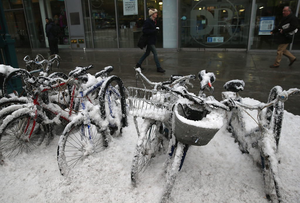 Description of . Bikes sit covered in snow near Union Square on February 5, 2014 in New York City, United States. New Yorkers, like millions of Americans in the northeast, dealt with the latest winter storm, which dumped 4 inches of snow on Central Park before turning to rain.  (Photo by John Moore/Getty Images)