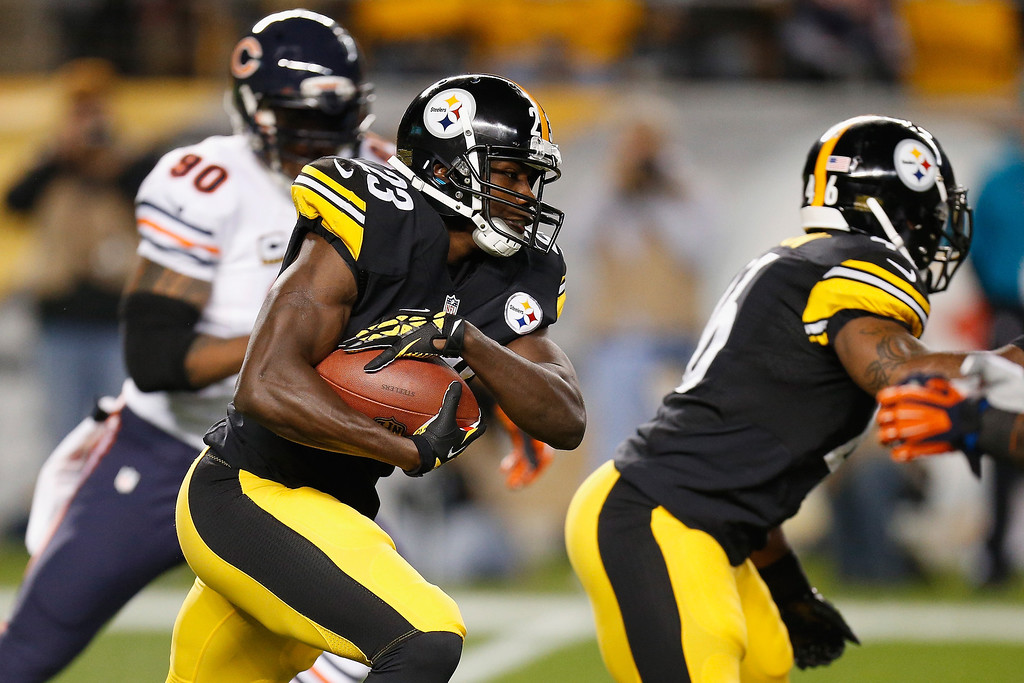 Description of . Felix Jones #23 of the Pittsburgh Steelers runs with the ball during a game against the Chicago Bears at Heinz Field on September 22, 2013 in Pittsburgh, Pennsylvania.  (Photo by Gregory Shamus/Getty Images)