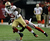 San Francisco 49ers' Vernon Davis (85) catches a pass with Atlanta Falcons' Thomas DeCoud defending during the first half of the NFL football NFC Championship game Sunday, Jan. 20, 2013, in Atlanta. (AP Photo/Dave Martin)