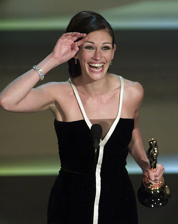 Description of . Actress Julia Roberts celebrates her Oscar win for Best Actress for her role in