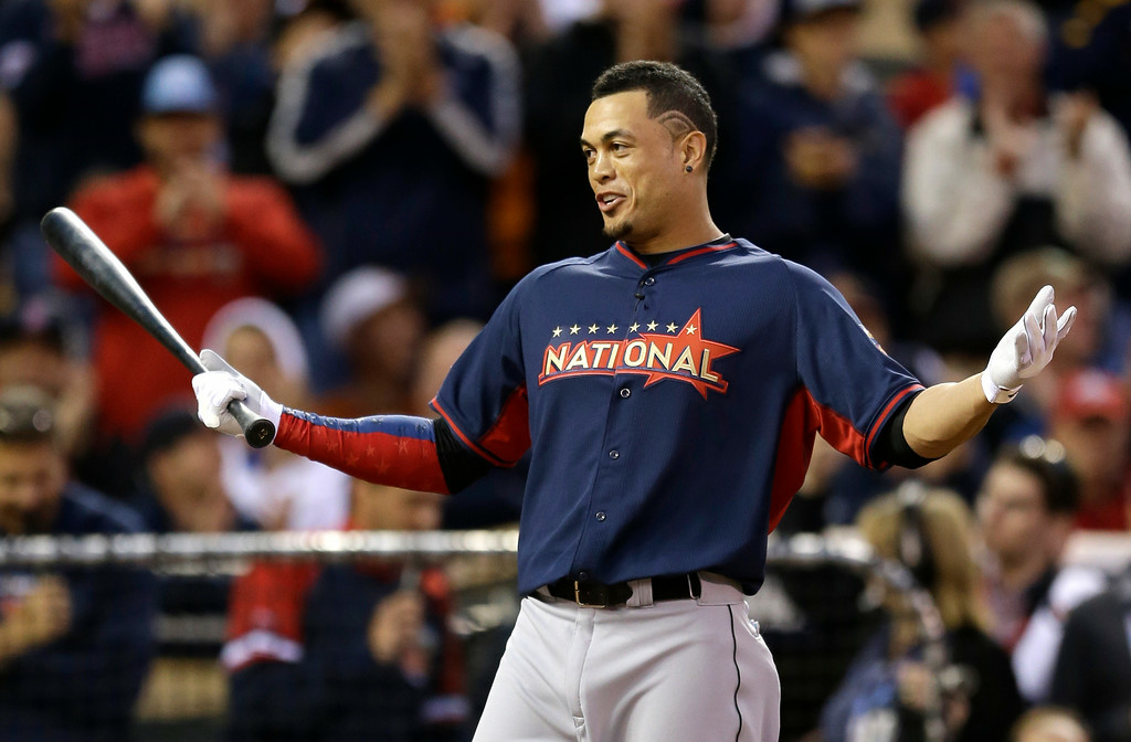 Description of . National League's Giancarlo Stanton, of the Miami Marlins, reacts during the MLB All-Star baseball Home Run Derby, Monday, July 14, 2014, in Minneapolis. (AP Photo/Jeff Roberson)