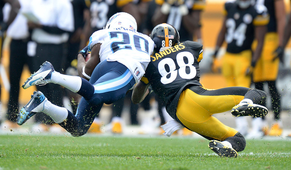 . Tennessee Titans cornerback Alterraun Verner (20) intercepts a pass intended for Pittsburgh Steelers wide receiver Emmanuel Sanders (88) in the second quarter of an NFL football game on Sunday, Sept. 8, 2013, in Pittsburgh. (AP Photo/Don Wright)