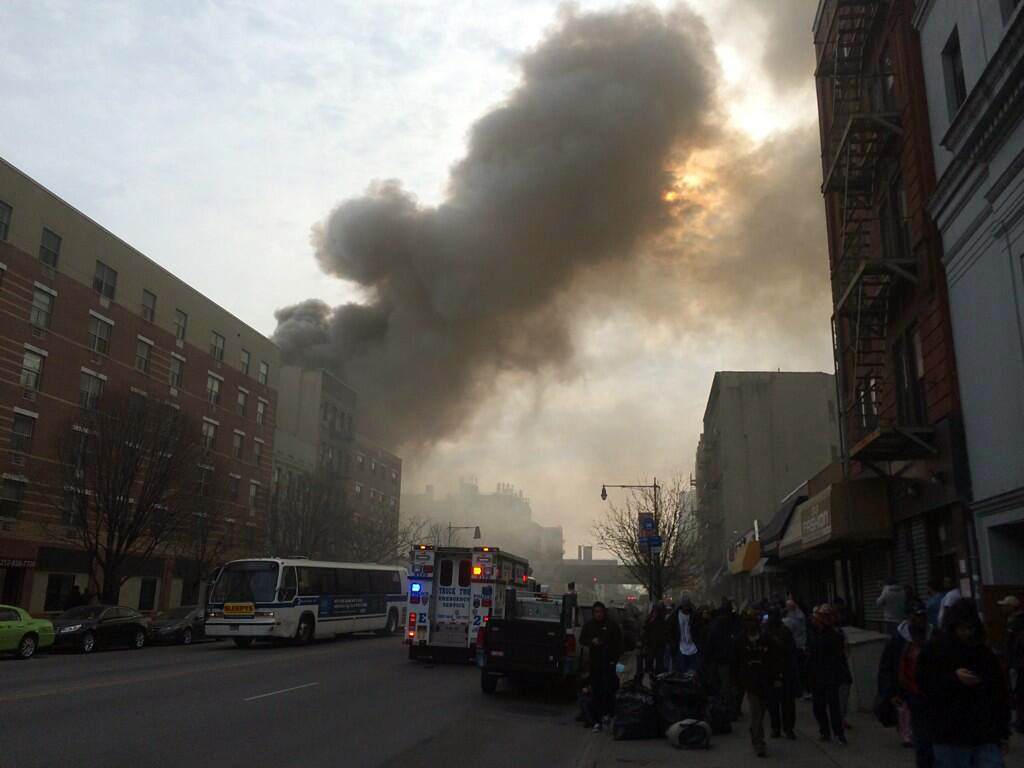 Description of . In this photo provided by Shane Kennedy, smoke rises from the site of an explosion and building collapse near Park Avenue and 116th Street in the East Harlem neighborhood of New York, Wednesday, March 12, 2014. (AP Photo/Shane Kennedy)