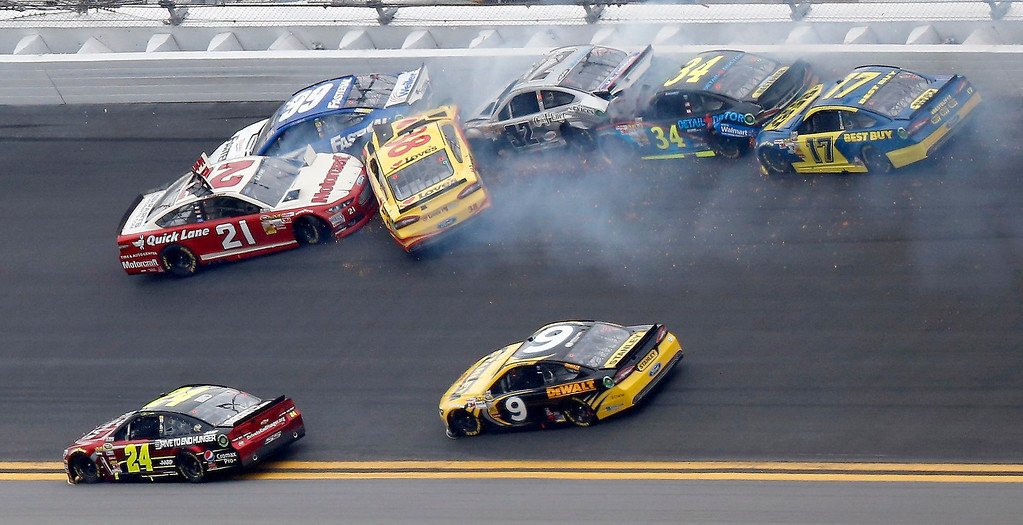 Description of . NASCAR driver Trevor Bayne (21) gets turned backwards in a wreck during the NASCAR Sprint Cup Series Daytona 500 race at the Daytona International Speedway in Daytona Beach, Florida February 24, 2013. REUTERS/Pierre Ducharme